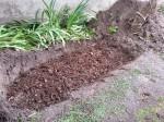 Tuyau poreux sous une couche de compost